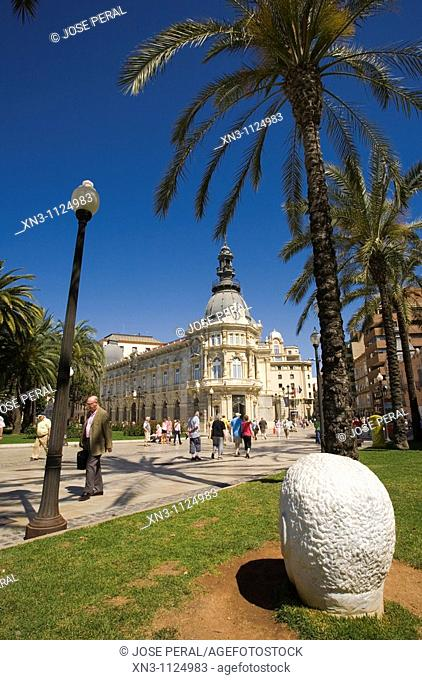On background Town hall, Cartagena, Costa Calida, Spain