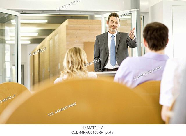 Businessman hosting seminar in office