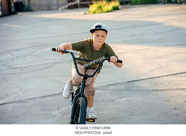 Boy riding bmx bike