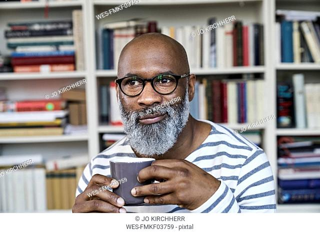 Mature man enjoying a cup of coffee