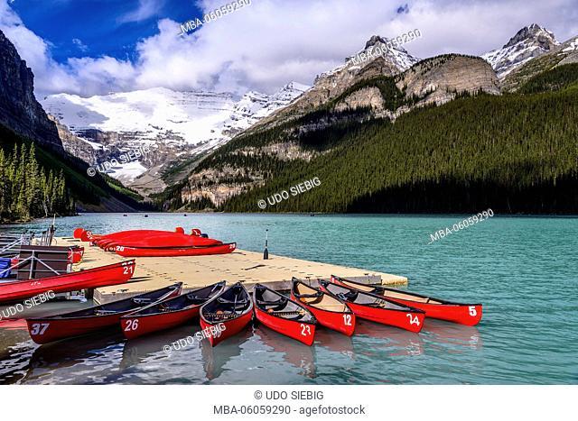 Canada, Alberta, Banff National Park, Lake Louise, Lake Louise canoes against Victoria Glacier