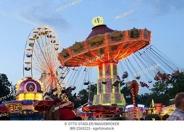 Swing caroussel and Ferris wheel at the Dult fun fair, Landshut, Bavaria, Germany, Europe