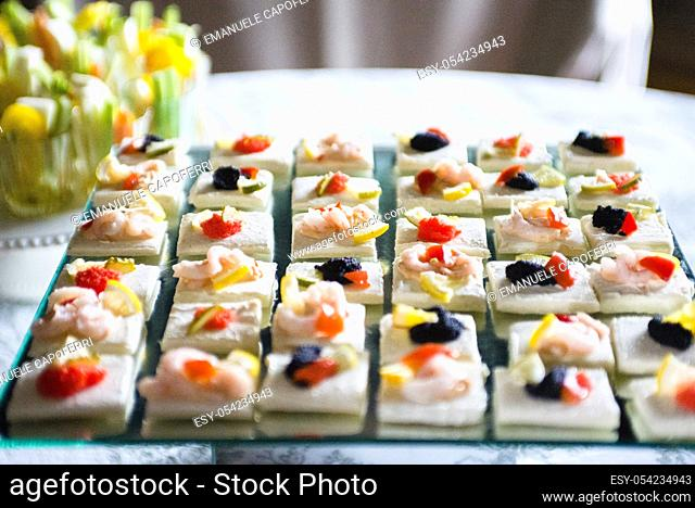 Table laden with shrimp appetizers for banquet