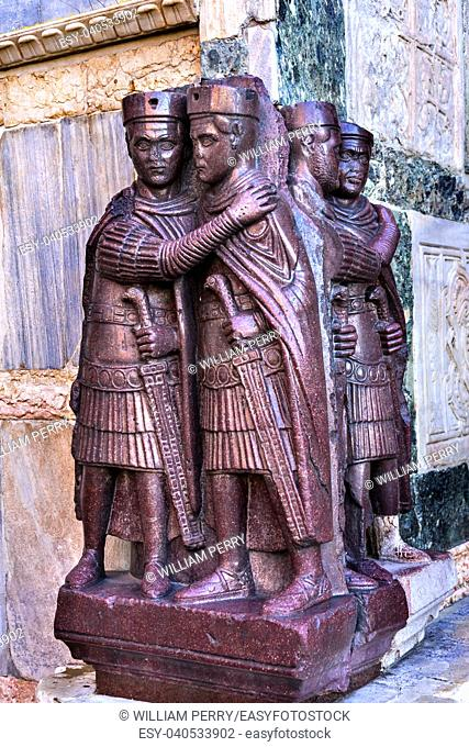 Four Tetrachs Purple Statue Corner Saint Mark's Basilica Venice Italy. Church created 1063 AD Tetrarchs statue is made from purple porphry stone from...