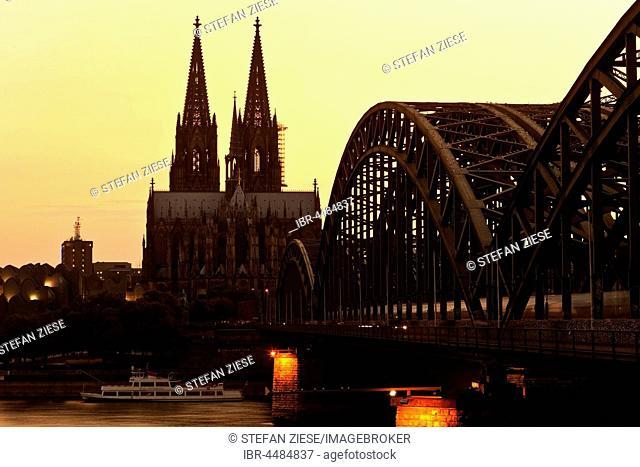 Cologne cathedral with Hohenzollern bridge at sunset, Cologne, Rhineland, North Rhine-Westphalia, Germany