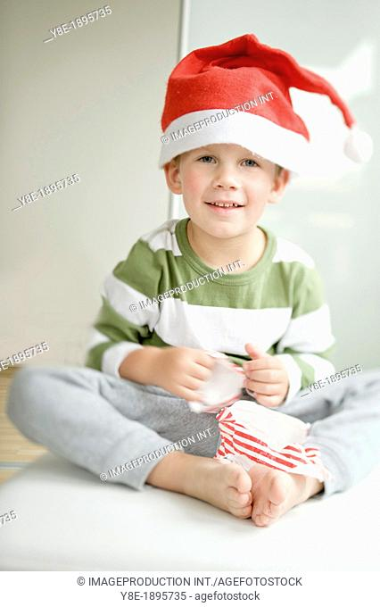 Czech Republic, Boy (4-5) wearing Santa hat