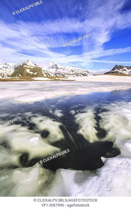 Ice melting at Lake Andossi during spring thaw, Chiavenna Valley, Spluga Valley, Sondrio province, Valtellina, Lombardy, Italy