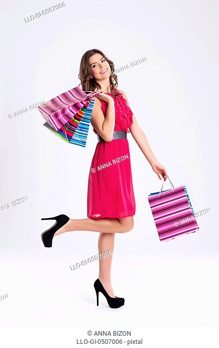 Shopping woman holding bags, Debica, Poland