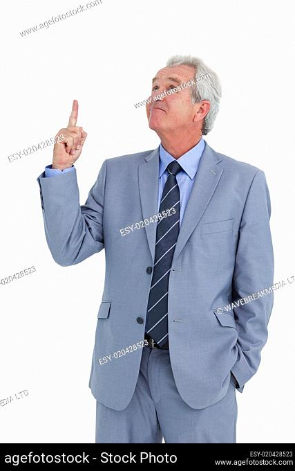 Mature tradesman pointing and looking up