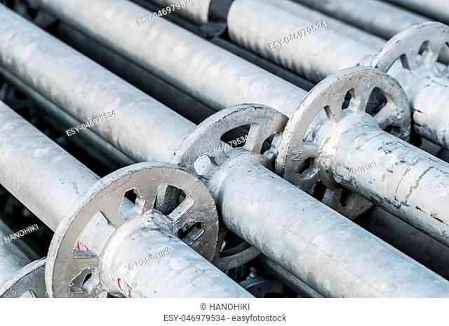 construction industry concept background - scaffolding parts closeup -