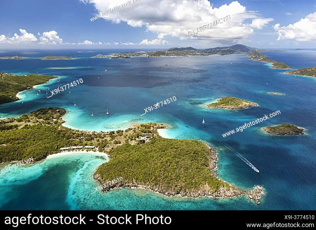 Aerial view of Caneel Bay on the island of St. John with St. Thomas in the distance in the United States Virgin Islands