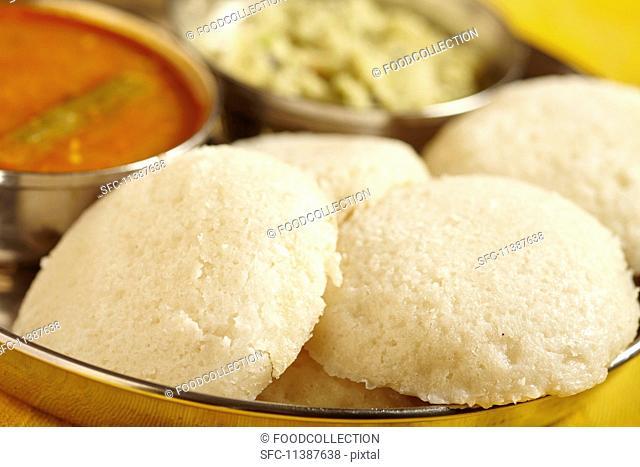 Idli (rice cakes with sambar soup and coconut chutney, South India)