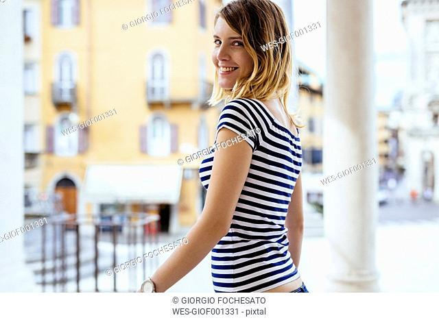 Italy, smiling young woman