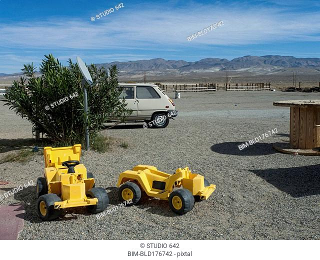 Toy bulldozers in rural desert park