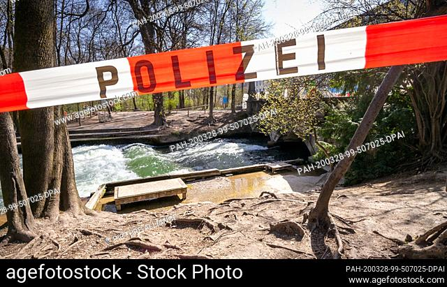 28 March 2020, Bavaria, Munich: The Eisbach wave, which is usually heavily frequented by visitors and surfers on weekends when the weather is good