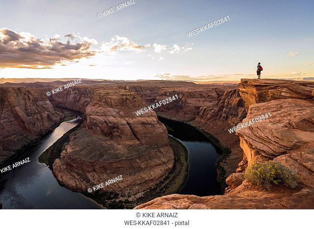 USA, Arizona, Colorado River, Horseshoe Bend, young man standing on viewpoint