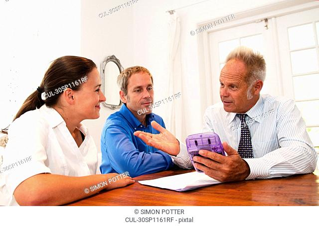 Salesman in discussion with couple