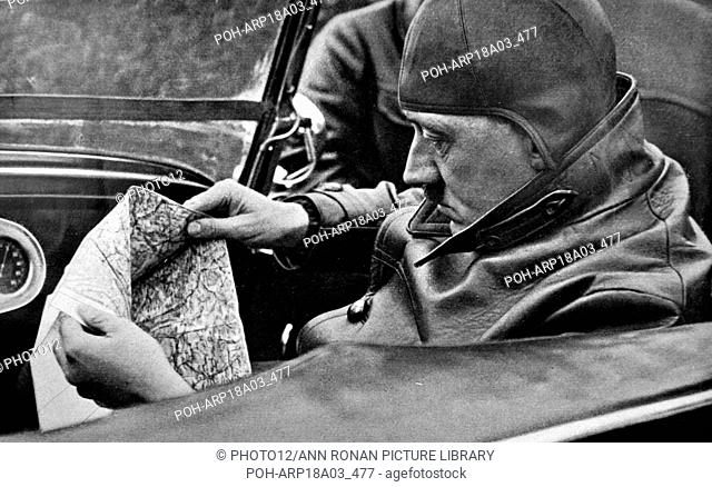 Adolf Hitler 1889-1945. driving on holiday near a country retreat. German politician and the leader of the Nazi Party driving a car