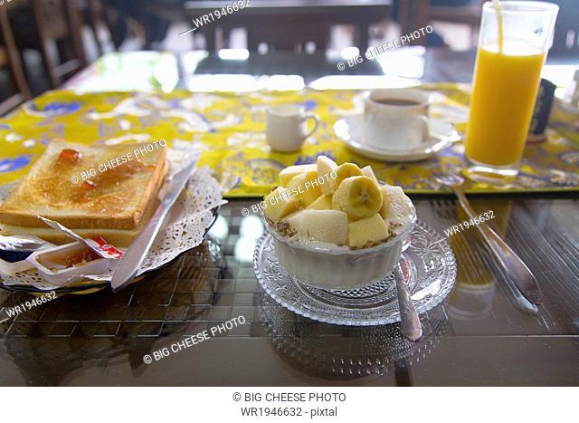 Fresh hotel breakfast on a sunny table