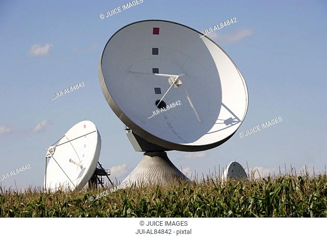 Parabolic antenna satellite dishes in field, Raisting, Bavaria, Germany