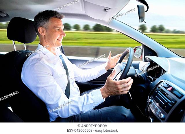 Side View Of A Happy Man In Self Driving Car