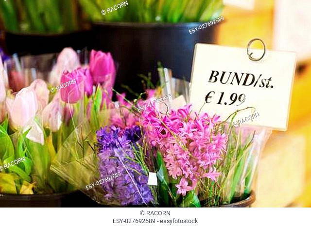 Closeup of various flowers with price tag in shop