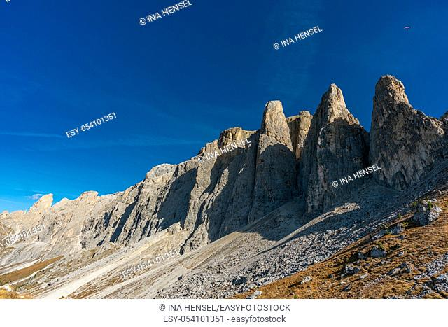 Beautiful panorama view of the Sellastock massif in the italian Dolomites mountains on a very sunny autumn day with dark blue skies