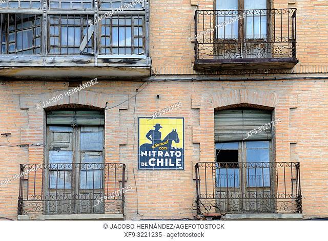Old, advertising sign of Nitrato de Chile. San Esteban de Gormaz. Soria province. Castilla y León. Spain