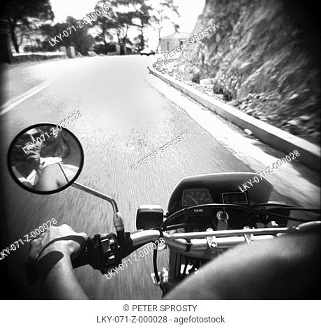 View from back of moped on highway