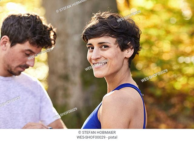 Couple during sport in forest