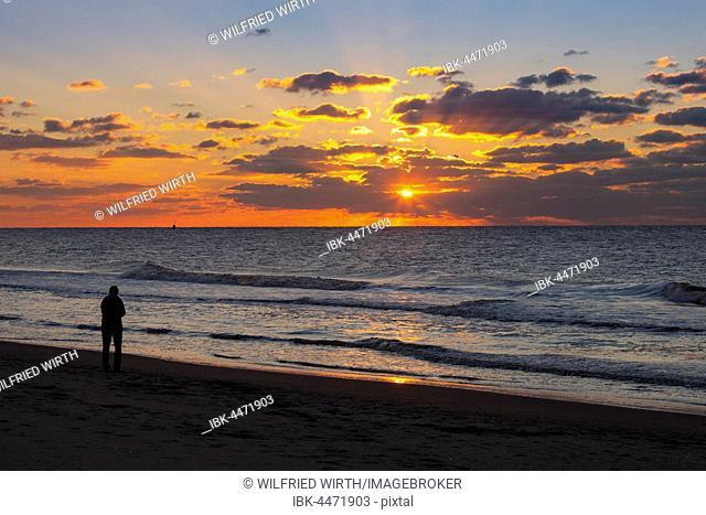 Person on the beach at sunset, Scheveningen, The Hague, Holland, The Netherlands