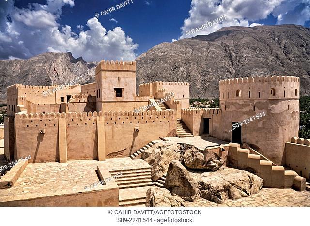 General view of Nakhl Fort, looking towards the mountains of Jebel Nakhl and the Hajar Mountain range, Nakhl, Al Batinah South Governorate, Oman