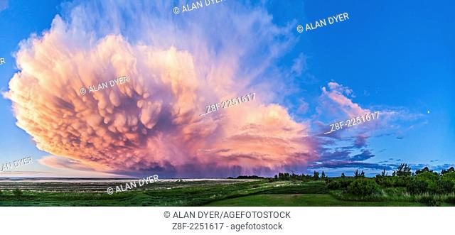 A 3-section panorama of a retreating thunderstorm taken from my back deck, with the Canon 5D MkII and 16-35mm Canon lens at 16mm