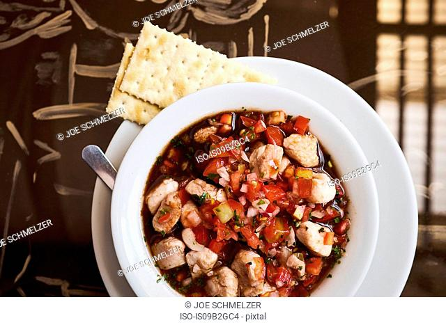 Overhead view of bowl with meat stew and crackers, Antigua, Guatemala