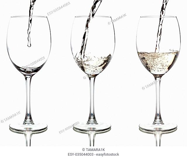 white wine pouring into a glass, isolated on white