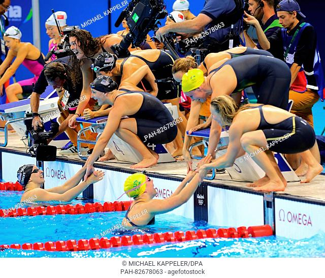 The teams of the USA and of Australia (R) congratulate each other after the Women's 4 x 200m Freestyle Relay Final of the Swimming events of the Rio 2016...