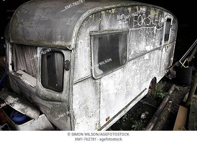 Dirty old neglected caravan