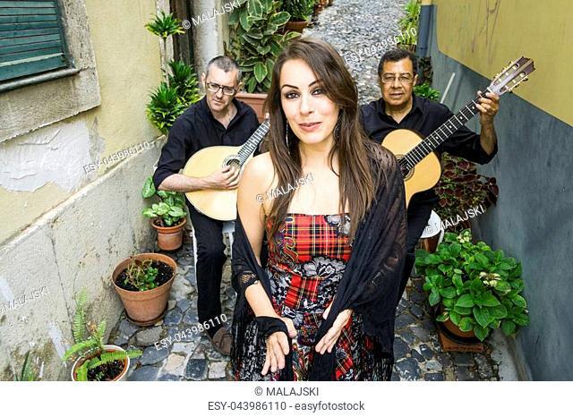 Fado band performing traditional portuguese music on the narrow street of Alfama, Lisbon, Portugal