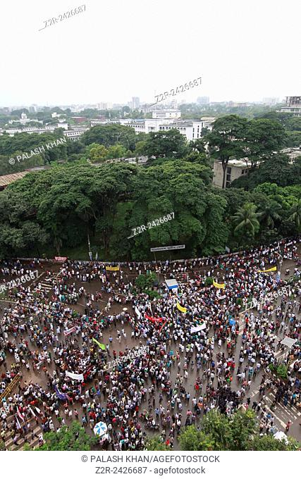 Thousands of activists from 18 Parties Alliance led by Bangladesh Nationalist Party (BNP) gather on a street during a rally at Suhrawardy Udyan in Dhaka in...
