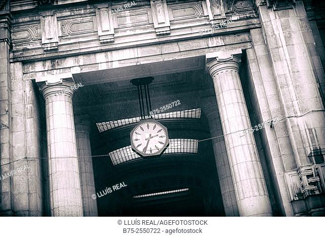 Clock ticking 2:35 p.m., in the building of the railway station of Milan, Italy, Europe