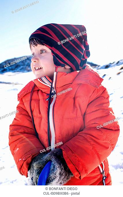 Toddler boy playing in snow, Piani Resinelli, Lombardy, Italy