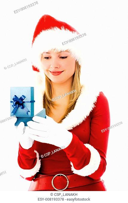 pretty girl dressed as Santa opens a Christmas present