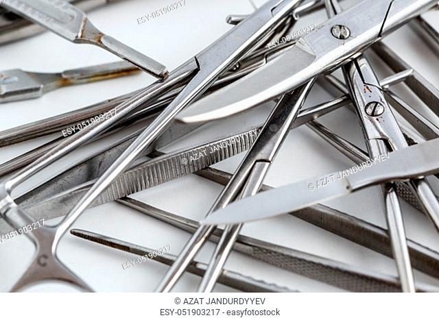 surgical instruments on white isolated background. top view