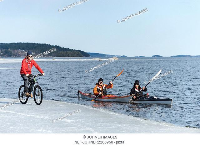 People kayaking and skiing