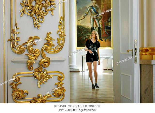 Saint Petersburg Russia. Hermitage Museum in the Winter Palace. Through doorway to young woman visitor in the Fieldmarshals Room