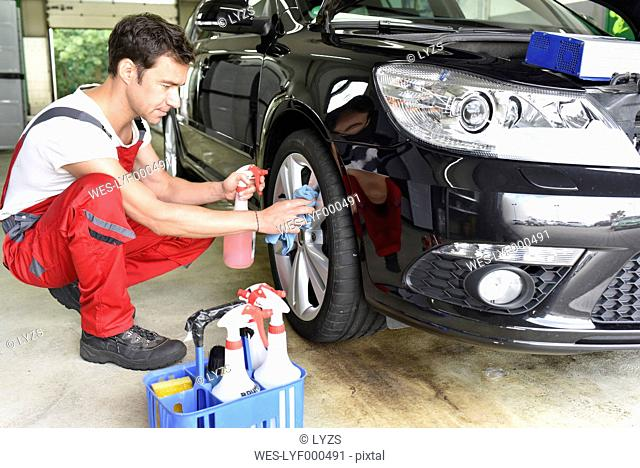Car cleaning, man cleaning car, alloy wheel