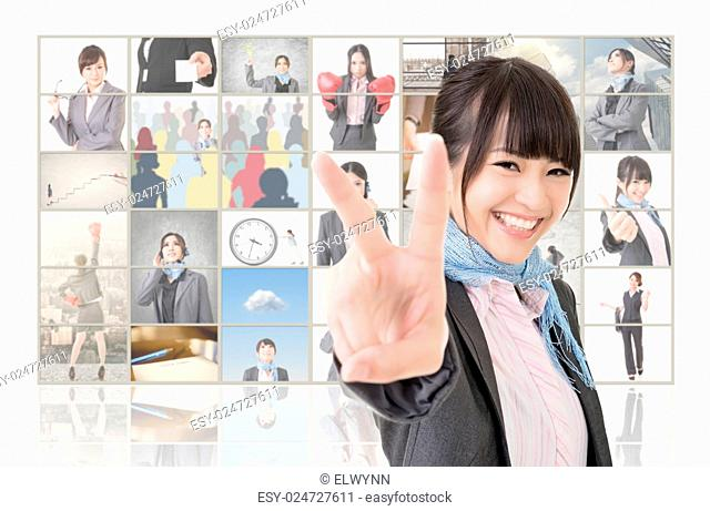 Confident Asian business woman give you a victory sign and standing in front of TV screen wall, closeup portrait
