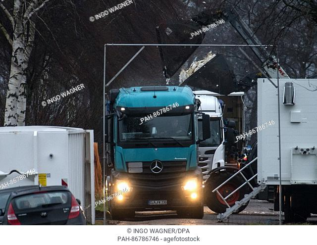Killed turkeys are taken out of a feeding stall and are thrown into bins on a truck with two shovel loaders near Doetlingen, Germany, 25 December 2016