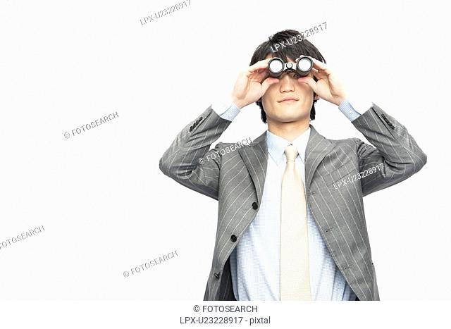 Businessman Through Binoculars