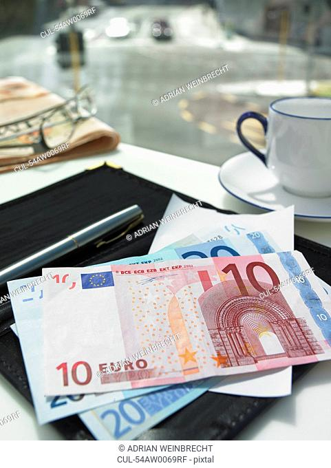 Money in check on restaurant table